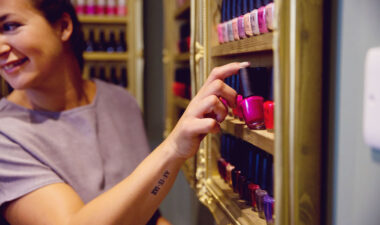 woman taking nail varnish from shelf, Eden Beauty, Southend